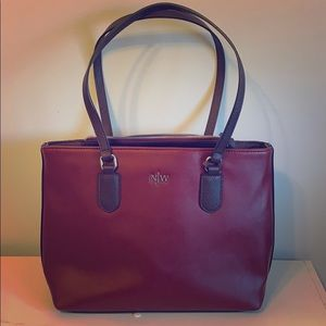 Nine West burgundy handbag with silver accents.